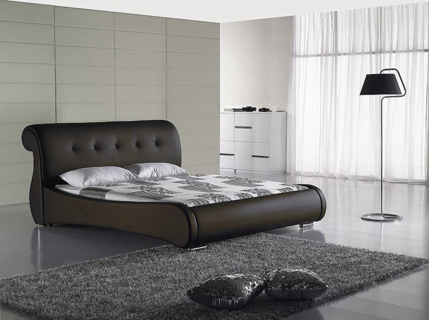A gas-lift storage bed with an elegant black vinyl curved headboard with button-tufting detail. This bed does not need a box spring. The result of the gas-lift storage is a sleek design with no indication of the hidden storage potential.