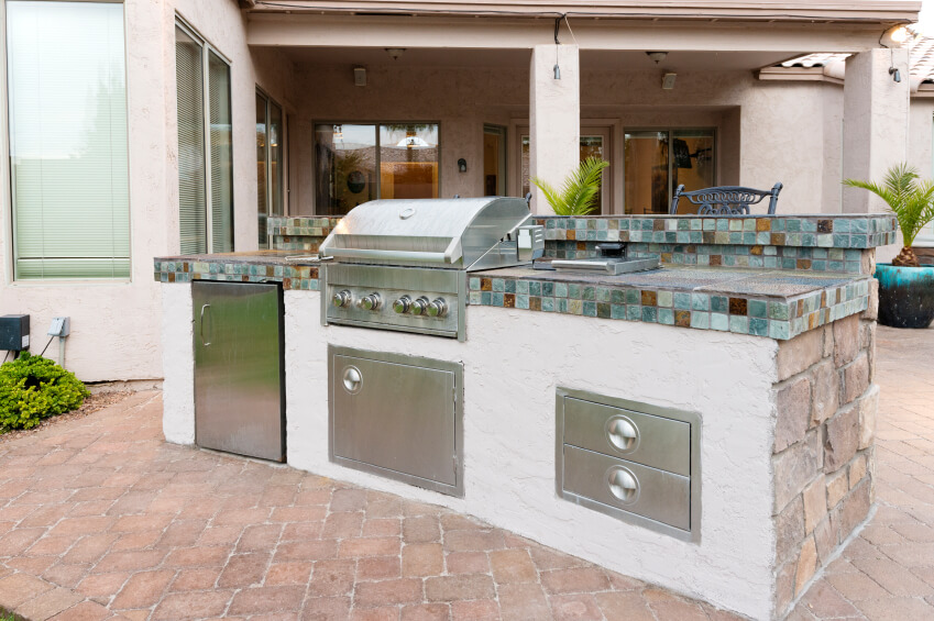 Outdoor Kitchen Tile : This freestanding outdoor kitchen island features an intricate tile ...