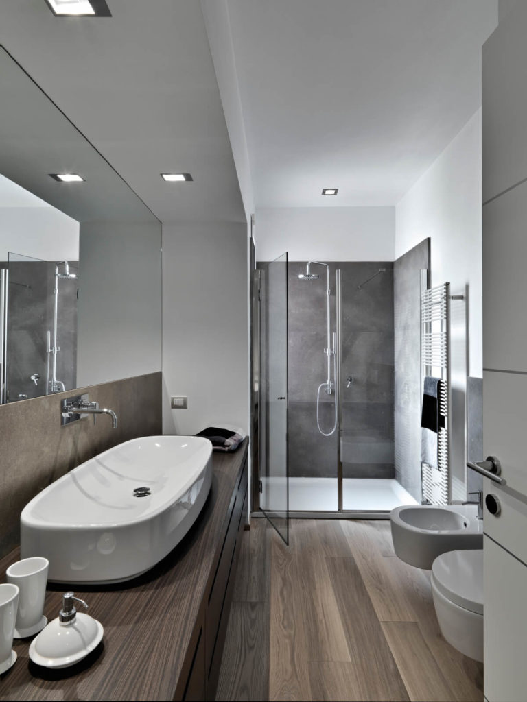 26 master bathrooms with wood floors pictures for Hardwood floor in bathroom