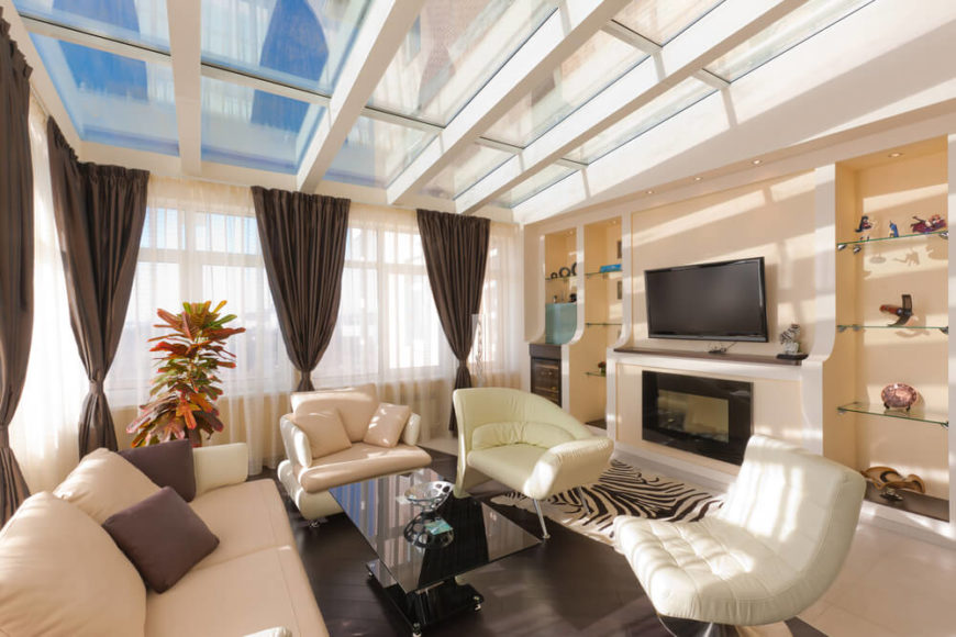 This Quaint Living Room Has A Skylight For A Ceiling, Lighting The Entire  Room With