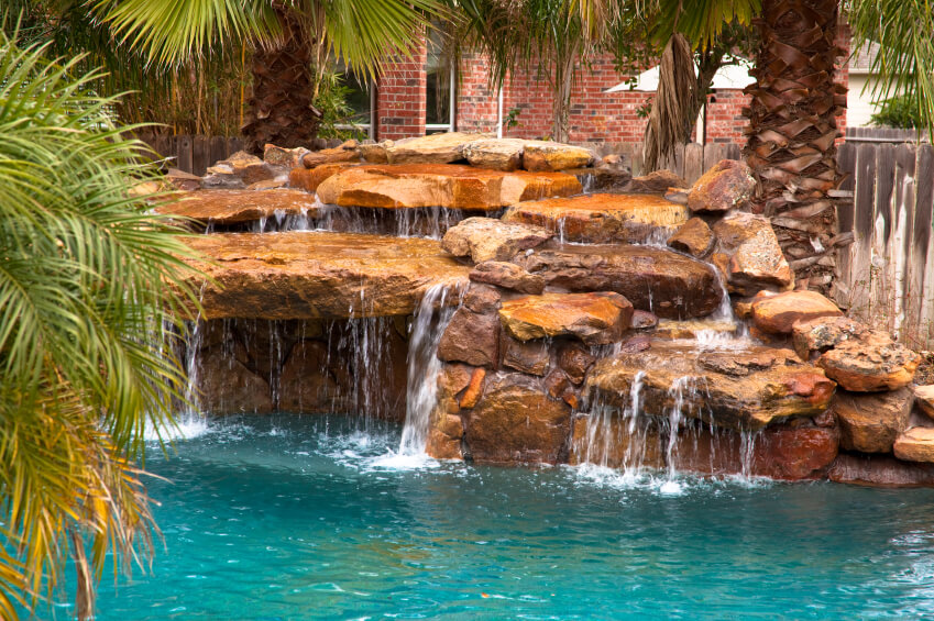 Swimming Pool Waterfall Designs pools with waterfalls design ideas backyard pool in ground pools pool with slide A Layered Man Made Waterfall Where The Water Cascades Over The Multiple Tiers Of Rock