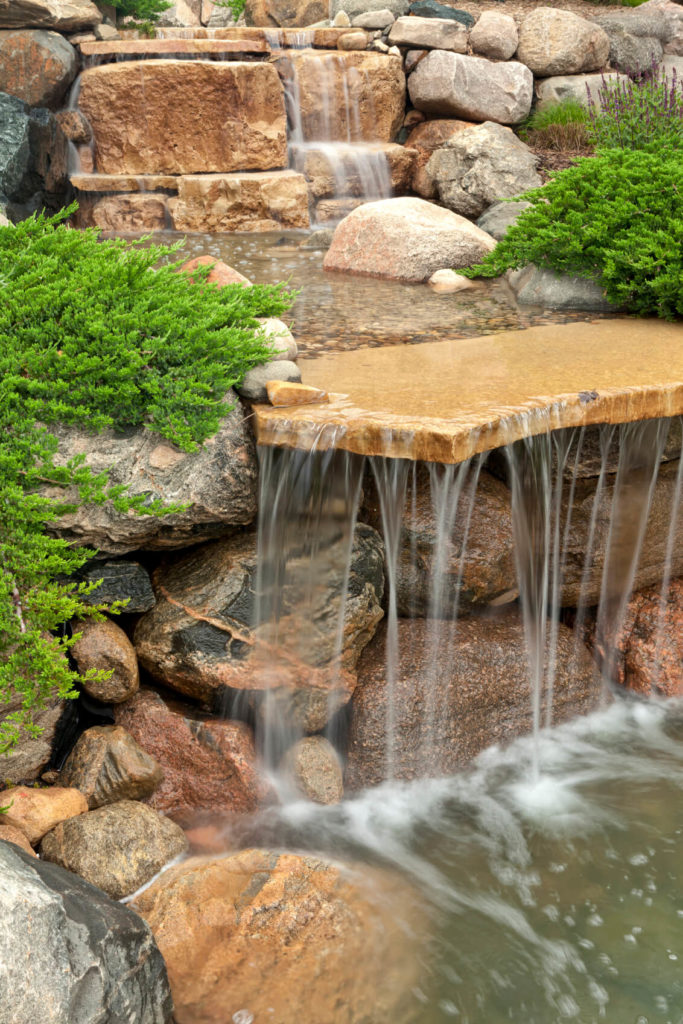 Waterfall Landscape Design Ideas homemade pondless waterfall landscape pondless waterfall design A Closer Look At The Side Of The Waterfalls Shelf A Low Evergreen Ground Cover
