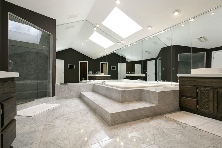 This Stunning Bathroom Features Glossy Squares Of Stone Tile, Soaring  Ceilings, And Wall Length