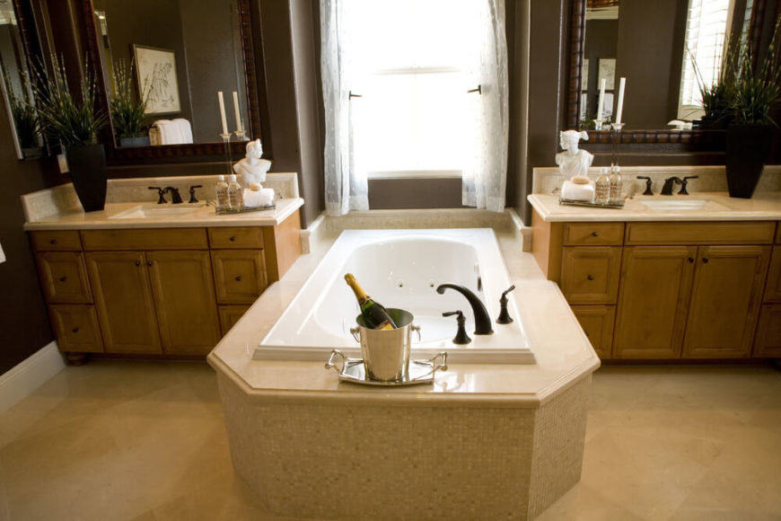 This Bathroom Features Vanities Separated By A Delicately Tiled Bathing Area Again We See