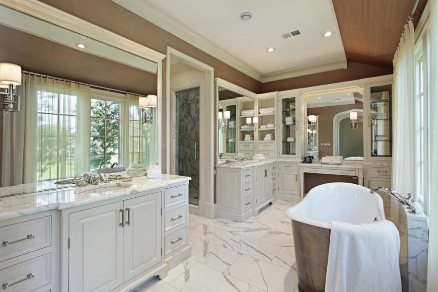 This Extraordinary Bathroom Features White Cabinetry And Beautiful Tile Flooring The Gorgeous Bathtub Reflects The