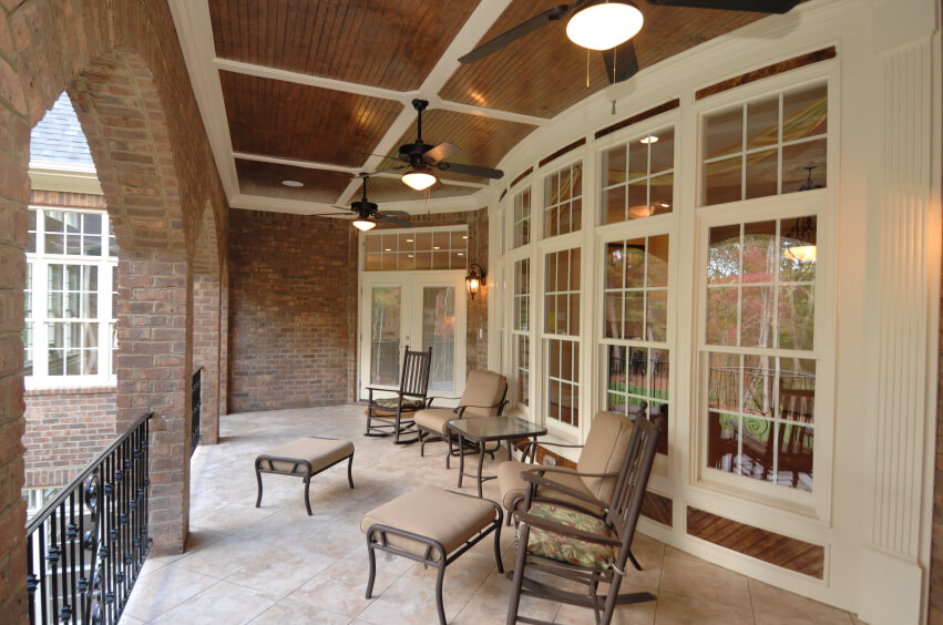 this gorgeous covered terrace has a black wrought iron balustrade running between each brick arch - Covered Patios Ideas