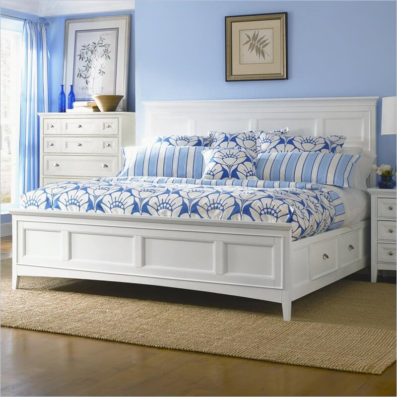 a white panel bed with four under bed storage drawers a crisp white finish