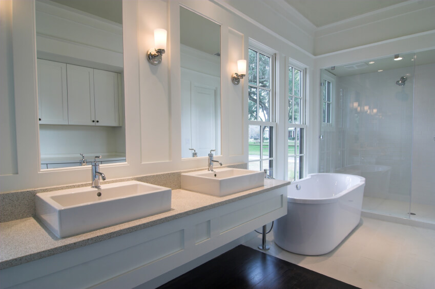 This Bright White Bathroom Features A Simple Double Vanity Of Modern Design The Rectangular Raised