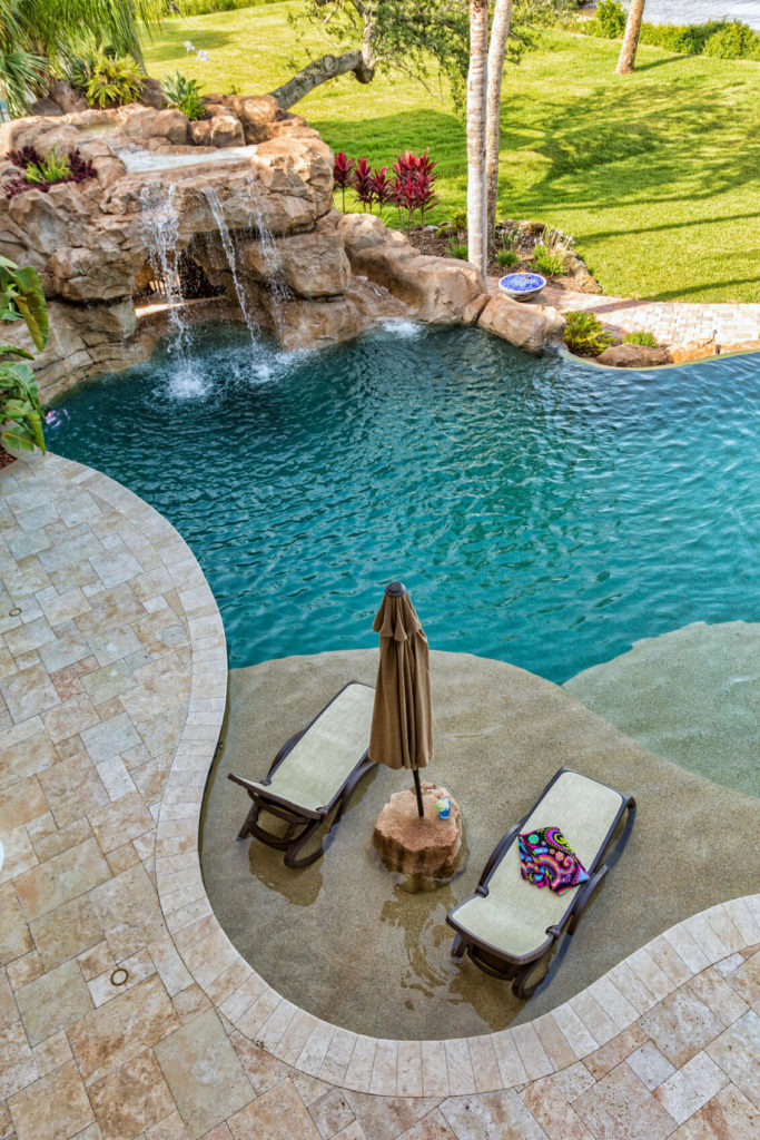 80 fabulous swimming pools with waterfalls pictures. Black Bedroom Furniture Sets. Home Design Ideas