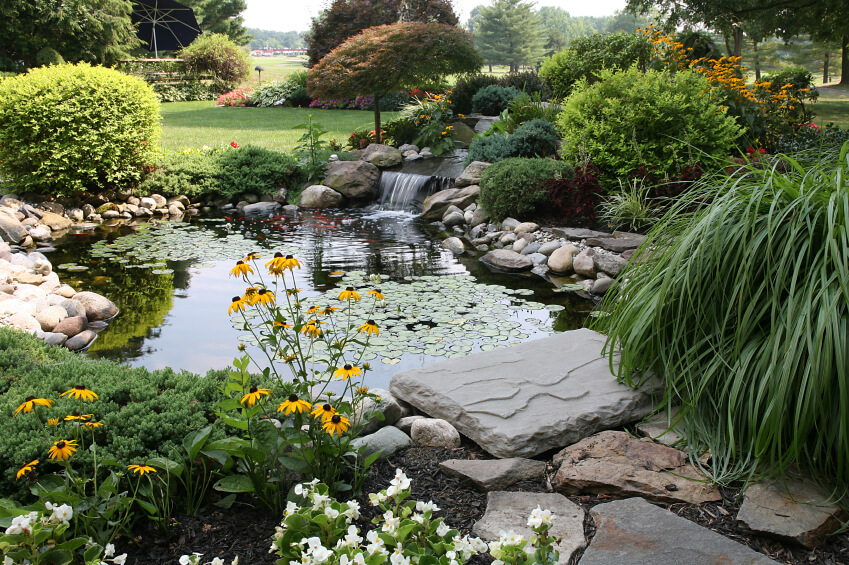 Waterfall Landscape Design Ideas lovable waterfall landscaping ideas waterfall landscaping ideas pictures design ideas amp decors This Pond Sits In The Center Of An Enormous Garden And Features A Two Tiered