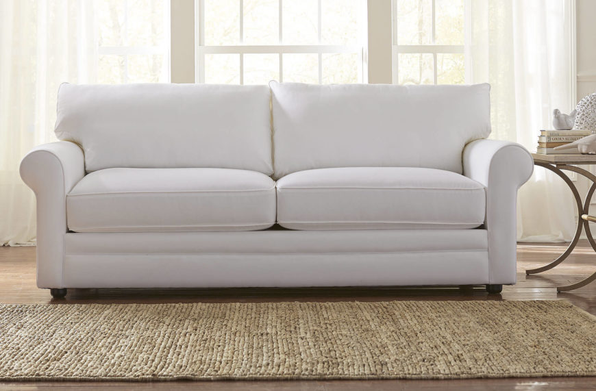 Here We Have A Plush All White Sofa With Roll Arms And Short