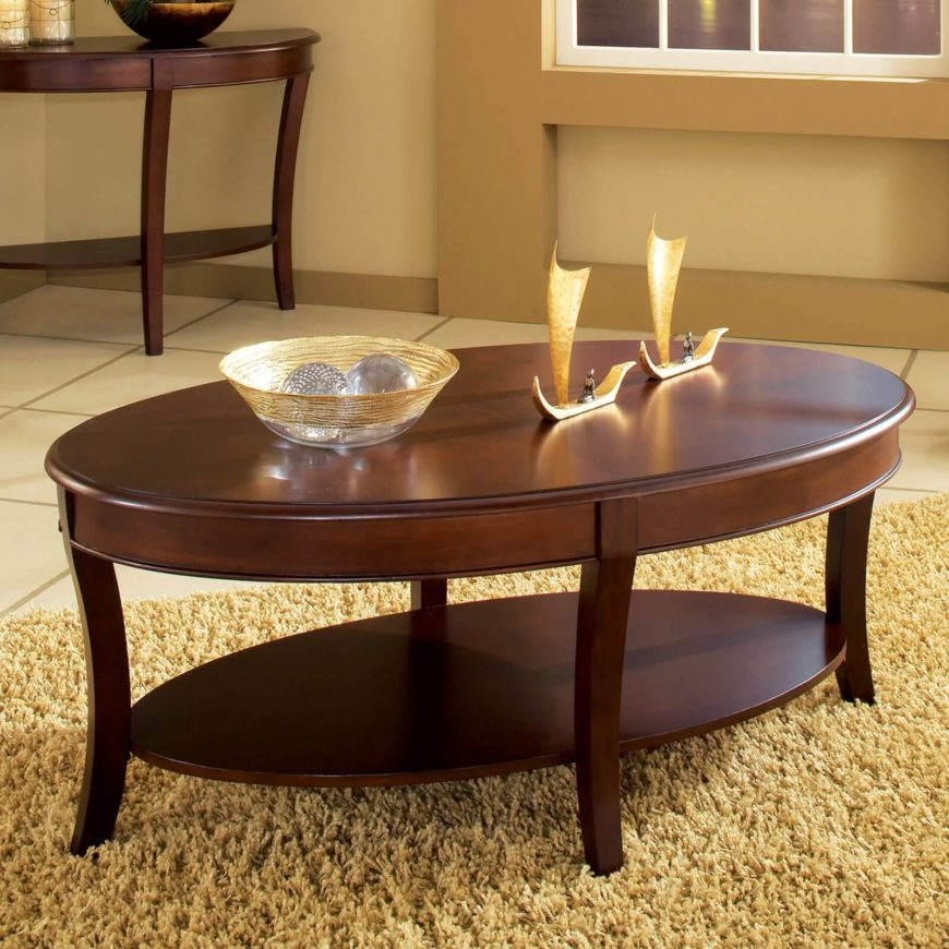 This Ornate Two Tier Coffee Table Features Intricate Carving And Sleek  Broad Surfaces. The
