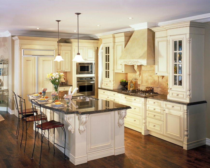 attractive Cream Kitchen Cabinets With Dark Floors #4: This kitchen is very elegant and gorgeous. The natural hardwood flooring  and rustic vent hood