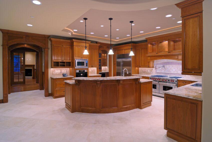 A Wood And Light Tile Kitchen With Archways Leading Out Into Various Other Parts Of The