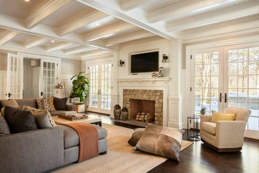 The Homes Great Room Has Coffered Ceilings And A Large Stone Hearth