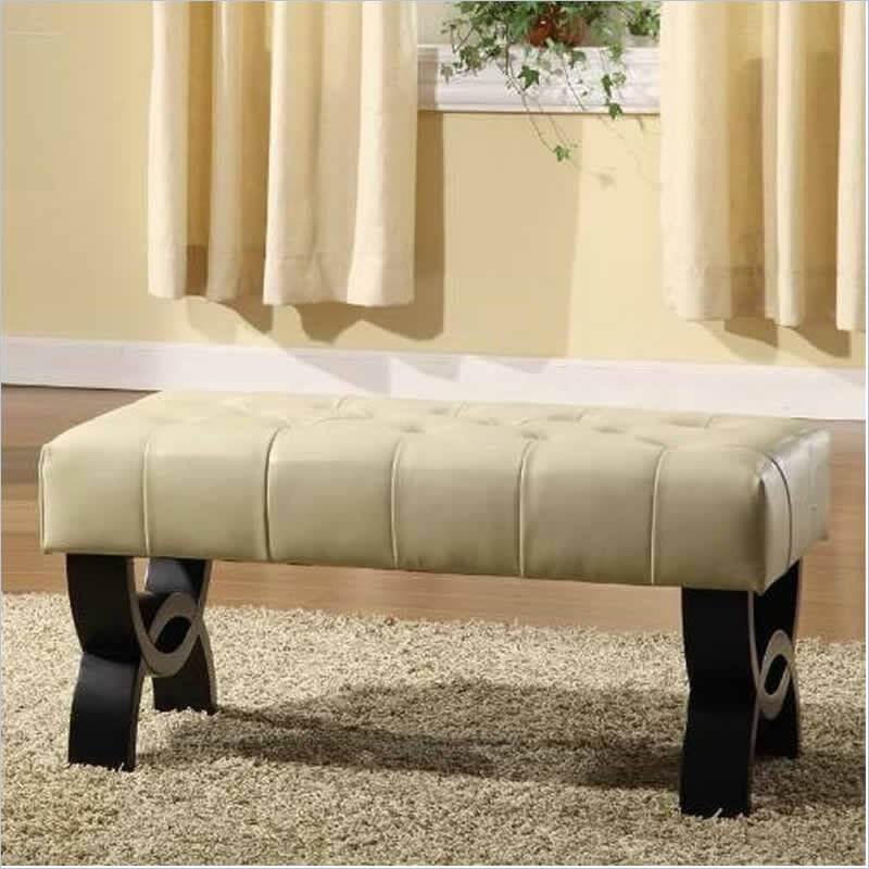 a long tufted ottoman in cream with dark wood legs that is perfect for two people