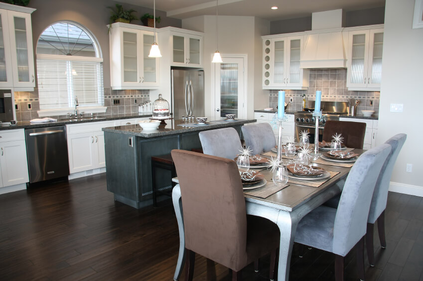 featuring beautiful white kitchen designs with dark hardwood flooring