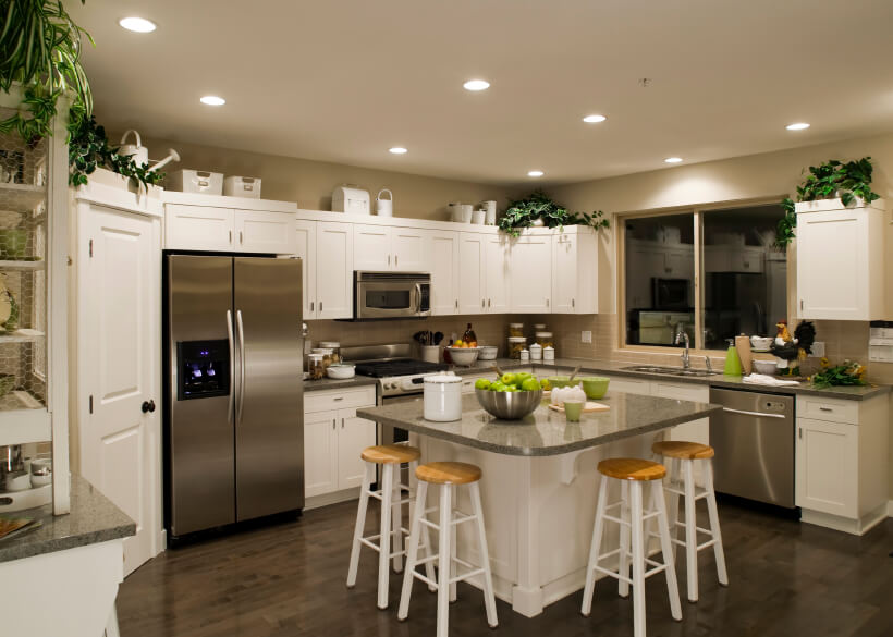 35 striking white kitchens with dark wood floors pictures for Armoire de cuisine rona