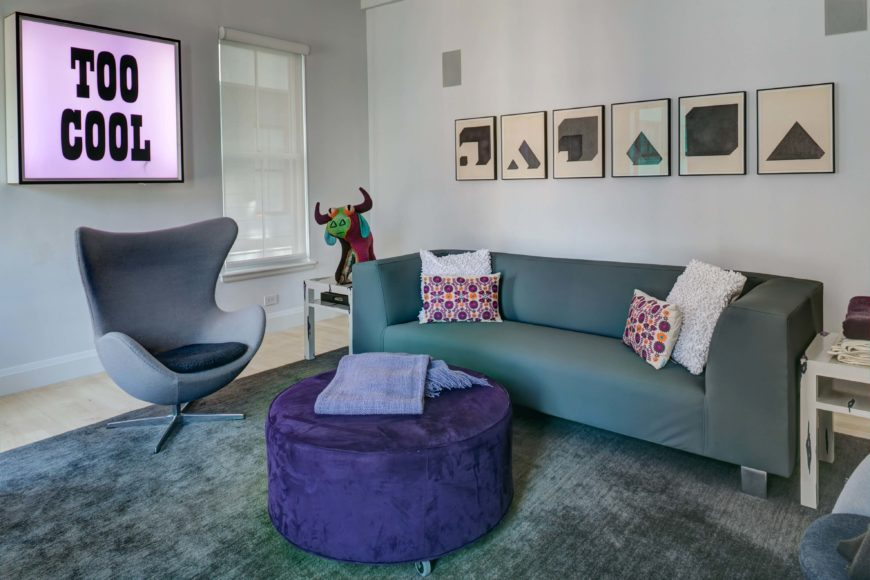 A Casual And Modern Living Room In Blues Purple With Single Small End Table