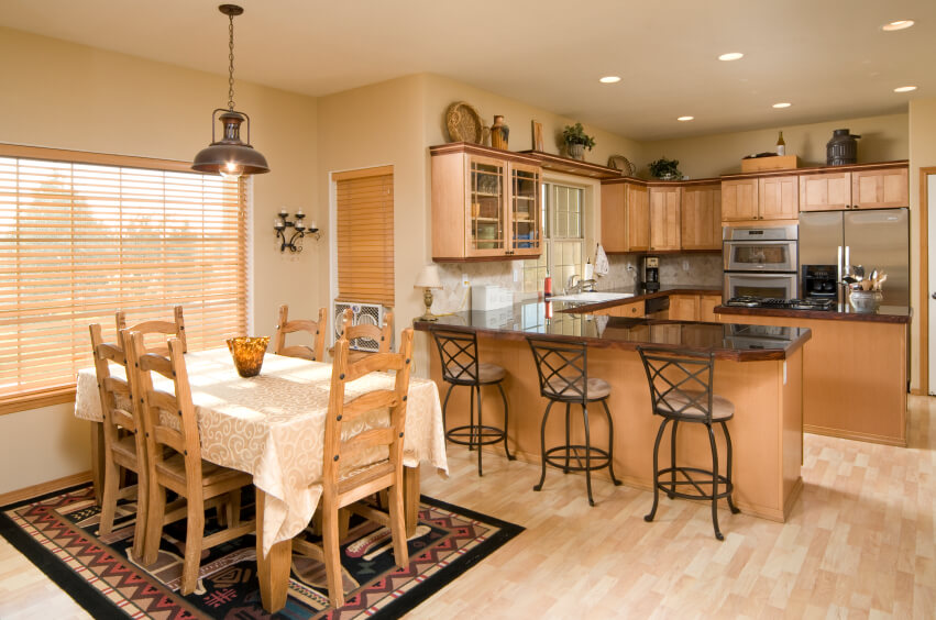 pale wood floors blend in with the neutral walls and allow the warm wood of the - Best Kitchen Countertops
