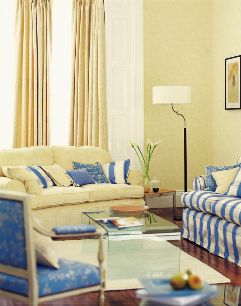 Blue and yellow living room with brown couch - The Subtle Texture Of These Butter Yellow Curtains Complements The Delicate Floral Motif Of The
