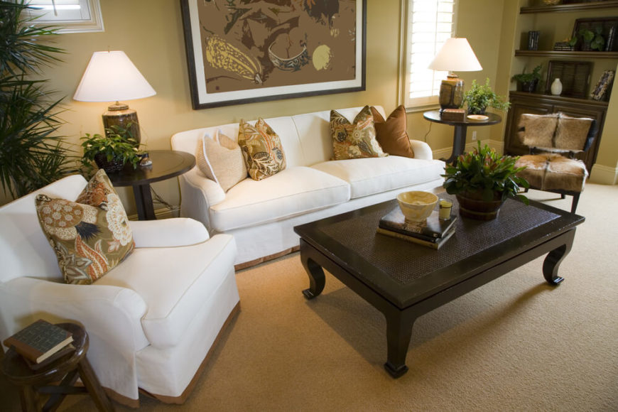 A Formal Living Room With Three End Tables Positioned So That Every Seat In The