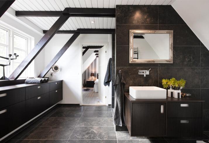 This upper floor bathroom sports large format marble tile flooring beneath  a host of natural. 32 Bathrooms with Dark Floors