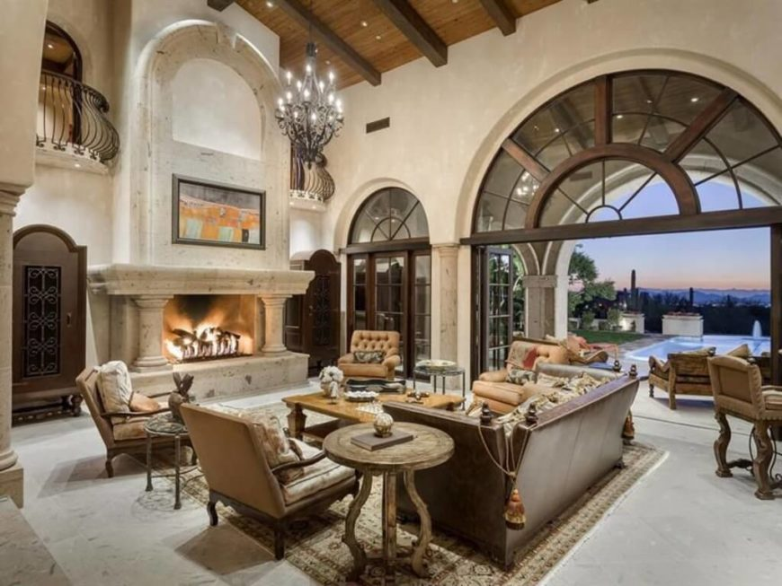 a stately traditional living room with soaring ceilings and huge windows and doors that lead outside - Traditional Living Room Design Ideas