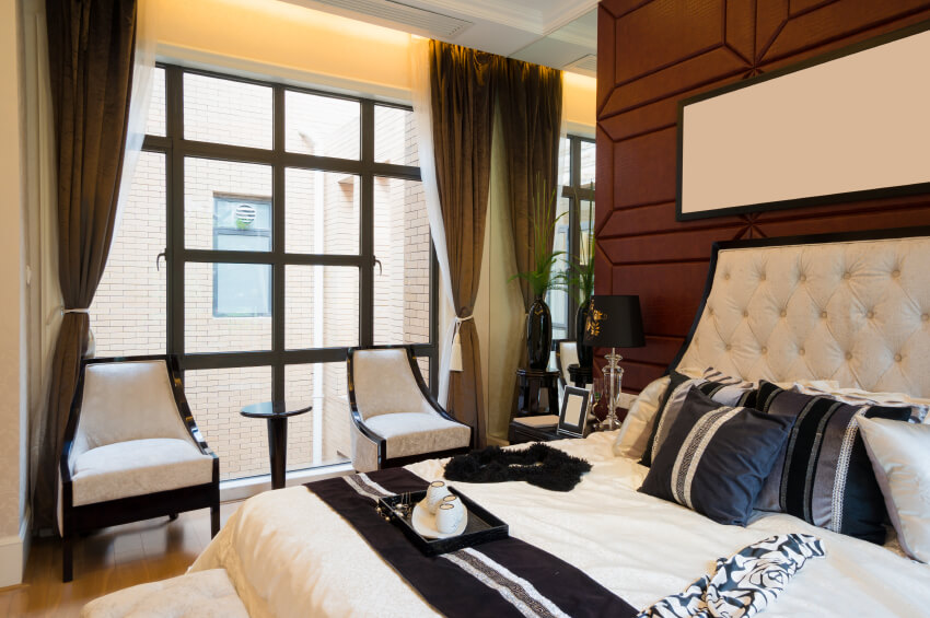 This Outstanding Bedroom Features A Luxurious Ivory Padded Headboard  Against A Chocolate Backdrop. Black,