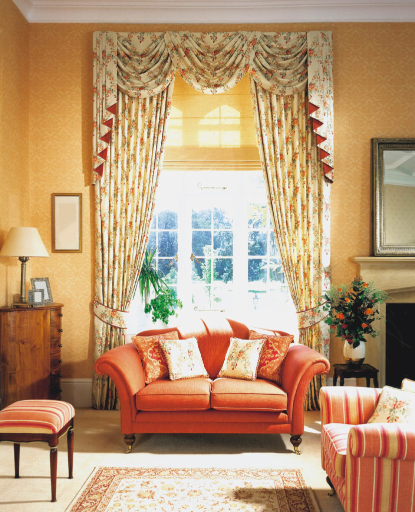 Orange curtains living room - This Traditional Living Room Has A Few Pops Of Color In The Furniture Upholstery Which