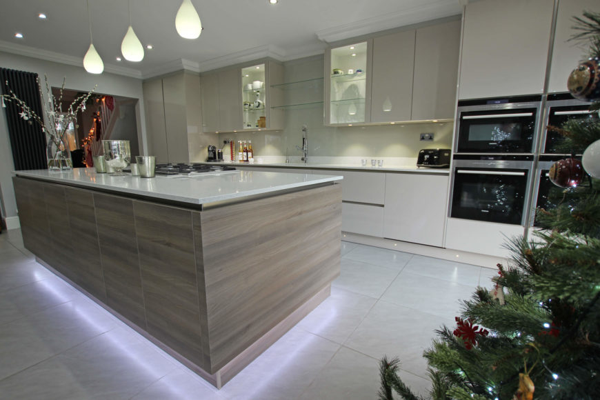 The cooktop adds an element of utility to this large island, as does built-