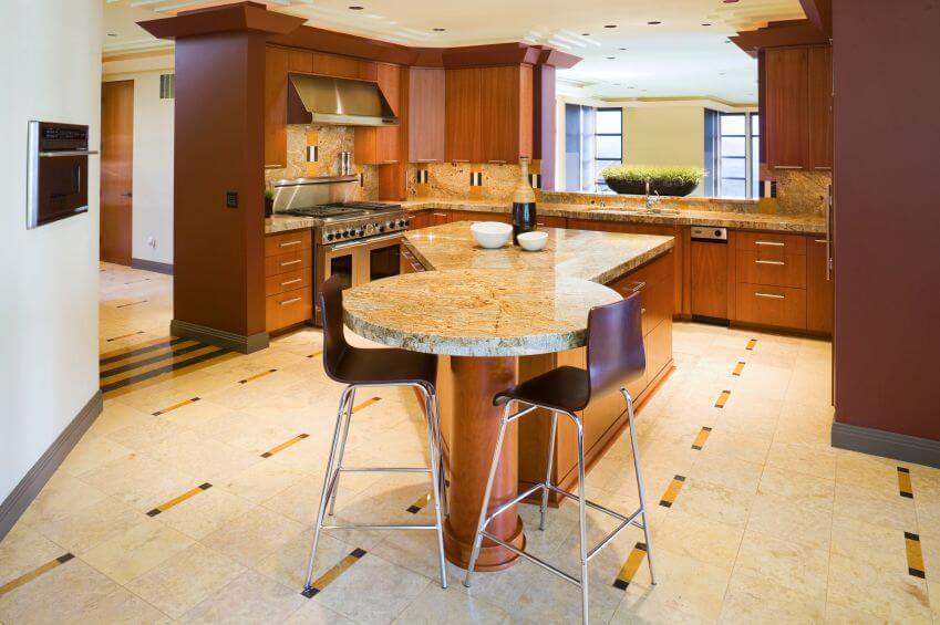 An L Shaped Kitchen With An Oddly Shaped Island That Doubles As An Eat