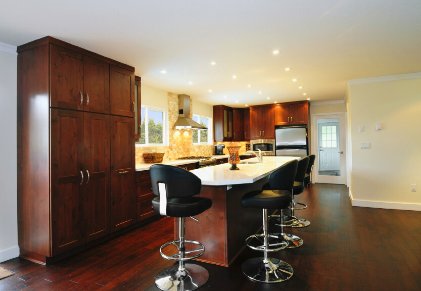 Natural Colored Cabinets With Charcoal Countertop
