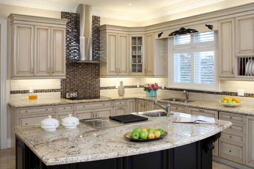 Countertop Dishwasher Pakistan : cream kitchen with light granite countertops and glass mosaic tile ...