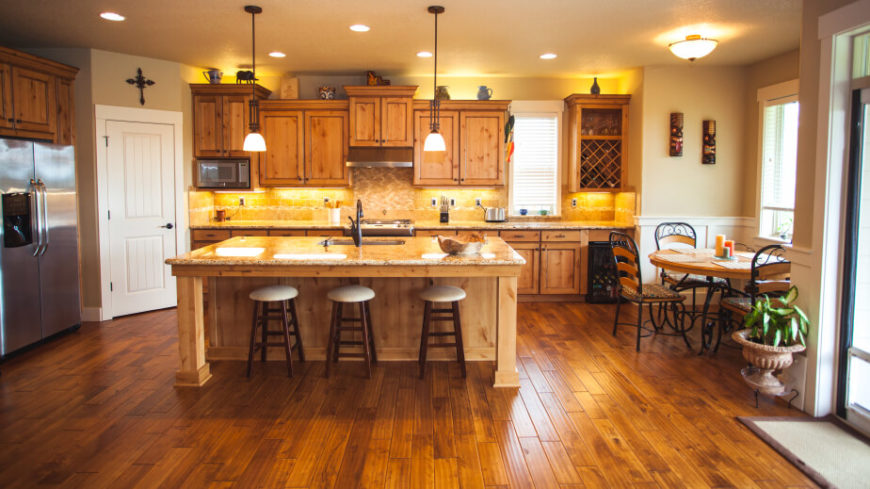 Kitchens with dark wood cabinets and rustic wood floors for Wood kitchen cabinets with wood floors