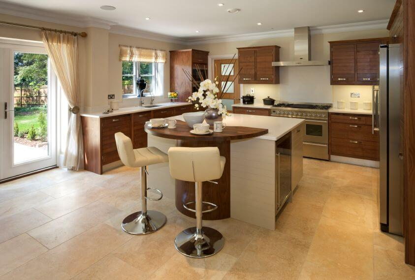 A contemporary white and wood kitchen with formica countertops and light  beige tile flooring. French