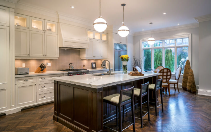 superior Cream Kitchen Cabinets With Dark Floors #1: A large bay window filters in natural light to this stunning kitchen. The  white marble