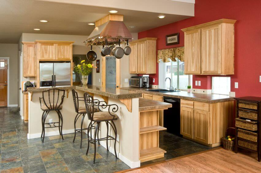 Superior An Eclectic Kitchen With Light Wood Cabinets Without Pulls And Tile Floors  In A Dusky Blue