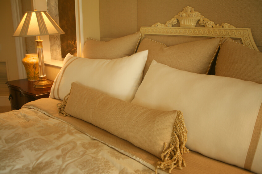 the gold and ivory design scheme of this room and the intricate attention to detail make