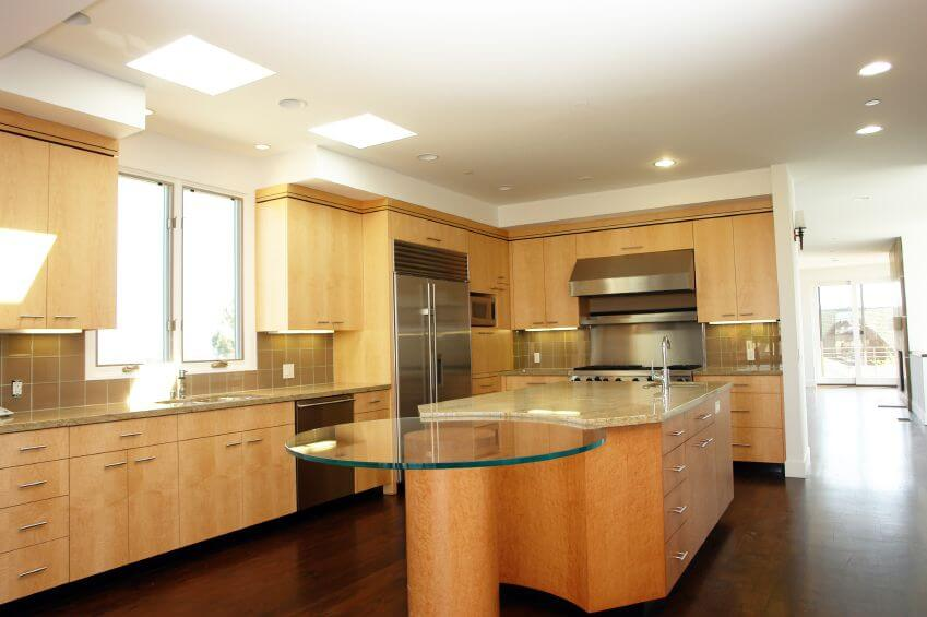 Another Modern L Shaped Kitchen With A Large Tile Backsplash In A Dark Beige