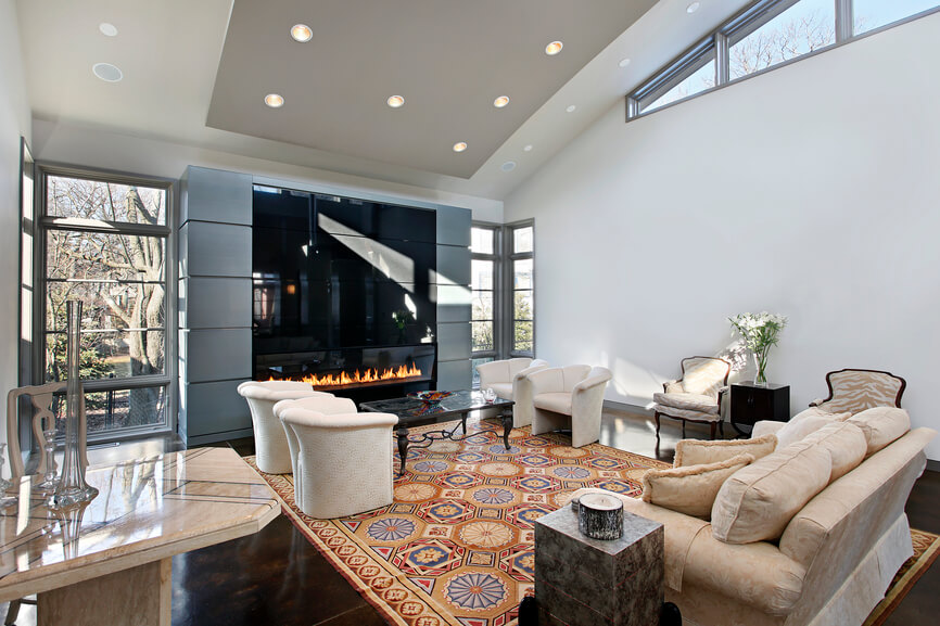 A Cavernous White Living Room With Huge Enclosed Gas Fireplace This Rooms Two Separate