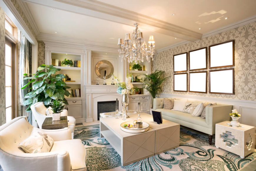 A Bold White And Blue Living Room With A Beautiful Crystal Chandelier Above  The Coffee Table Part 85