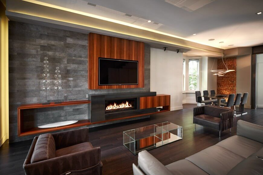 this gorgeous modern living room features dark hardwood flooring that
