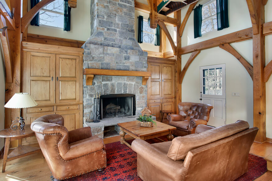 A Beautiful Rustic Living Room With Pine Built Ins On Either Side Of The Imposing