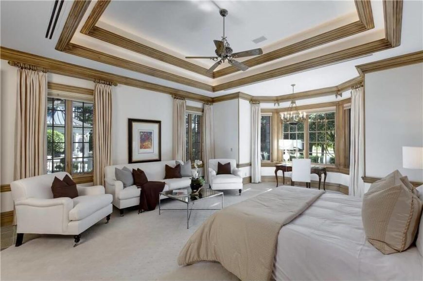 Perhaps the most stunning part of this room is the multiple tiers of tray  ceilings with