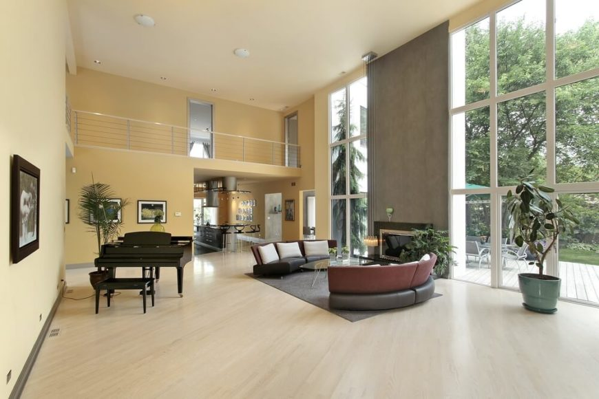 modern home has a very open floor plan the pale hardwood flooring