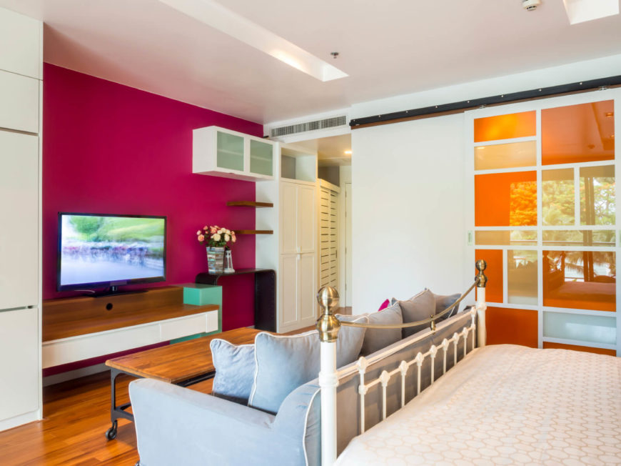 A Modern Style Bedroom That Combines Contemporary Bold Colors Like Berry  And Orange With Vintage