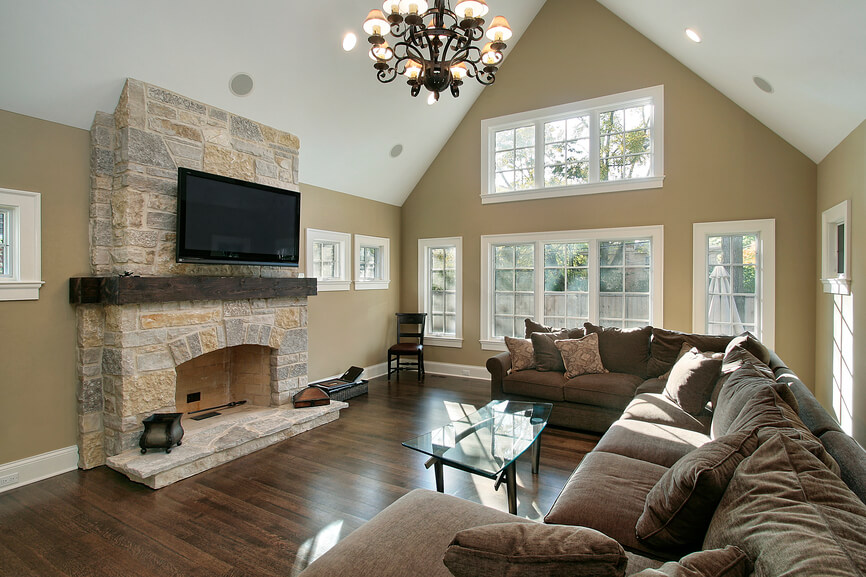 A New Construction Home With Beautiful Light Stone Wood Burning Fireplace And Large U