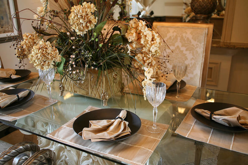 a cream and brown informal setting on a glass top table the dining chairs. beautiful ideas. Home Design Ideas