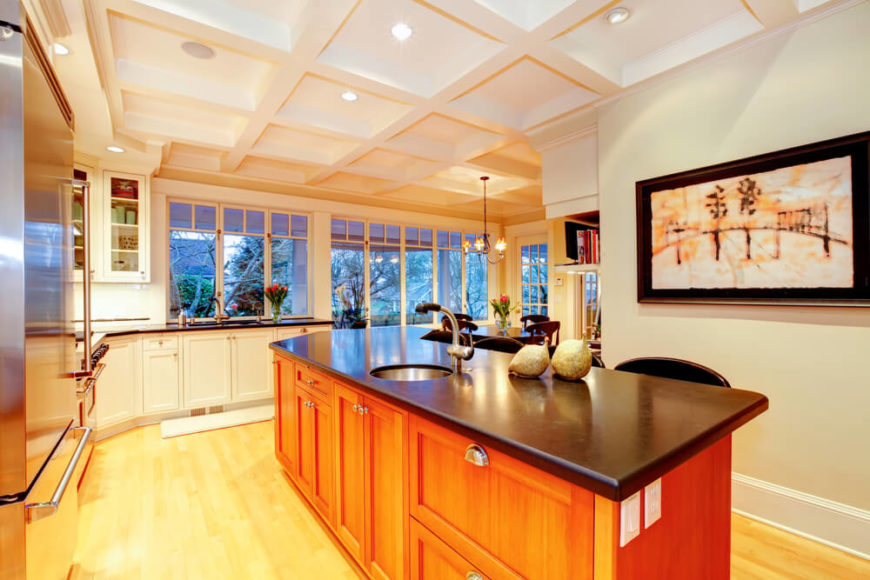 This Quaint Kitchen Dazzles Us With Lots Of Natural Wood And A Sleek Black  Counter Top Part 51